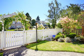 Front yard with white fence and landscape — Stock Photo
