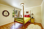 Extraordinary bedroom interior. Colorful carved wood bed with hi — Stock Photo