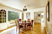 Dining area with round wooden table — Stock Photo