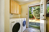 Laundry room with exit to backyard area — Stock Photo