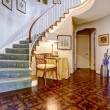 Luxury foyer with designed hardwood floor and spiral staircase — Stock Photo #53956125