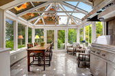 Sunroom patio area with transparent vaulted ceiling — Stock Photo