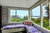 Cozy sitting area in bedroom with bay view — Stock Photo