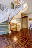 Luxury foyer with designed hardwood floor and spiral staircase — Stok fotoğraf
