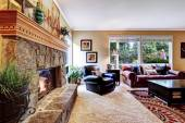 Luxury family room with cozy stone trimmed fireplace — Stock Photo