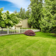 Beautiful front yard landscape with white fence — Stock Photo #54005865
