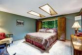 Luxury bedroom interior with skylights — Stock Photo
