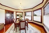 Luxury dining room with wood trim and built-in cabinet — Stock Photo