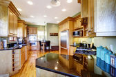 Kitchen with black shiny counter top — Stock Photo