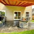 Patio area with tile floor and stone trimmed fire pit — Stock Photo #54161733