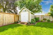 Fenced backyard with small shed — Stock Photo
