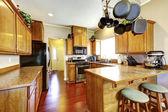 Kitchen room wtih hanging pot rack — Stock Photo