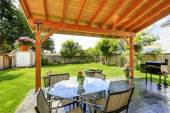Patio set with glass top table and chairs — Stock Photo