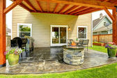 Patio area with tile floor and stone trimmed fire pit — Stock Photo