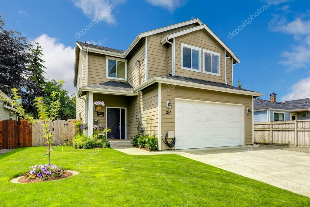 Two story house exterior with front yard landscape stock for Exterior 2 story homes