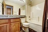 Simple bathroom interior with large mirror — Stock Photo