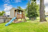Playhouse with deck and slide. — Stock Photo