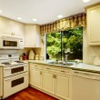 Simple kitchen interior in old house — Stock Photo #54311939