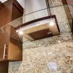 Modern steel kitchen hood with glass element — Stock Photo #54317753