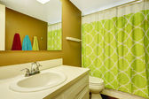 Bathroom with neon green curtain — Stock Photo