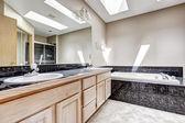Bathroom with granite tile trim and skylight — Stock Photo