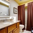 Modern bathroom cabinet with granite top. Brown curtains decorat — Stock Photo #54333697