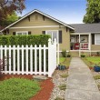American house exterior with white wooden fence — Stock Photo #54335341
