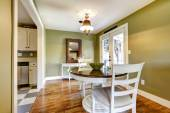 Dining room in green tones with exit to backyard — Stock Photo