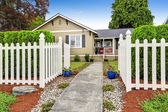 American house exterior with white wooden fence — Stock Photo