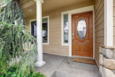 Wooden entrance door with glass trim — Stock Photo