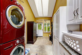 Hallway with laundry area and exit to backayrd  — Stock Photo