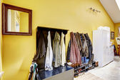 Hallway furniture full of clothes and shoes — Stock Photo