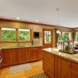 Large kitchen room with decorated island — Stock Photo #54420473