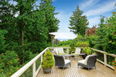 Romantic patio area on walkout deck with bay view — Stok fotoğraf