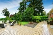 Walkout deck with patio area and backyard garden — Stock Photo