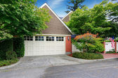 Garage with clapboard siding and brick trim — Stock Photo