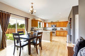 American house interior with open floor plan. Kitchen room and d — Stock Photo