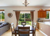 Dining area with walkout patio — Stock Photo
