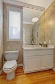 Restroom with white vanity cabinet — Stockfoto