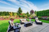 Impressive backyard landscape design with patio area — Stock Photo