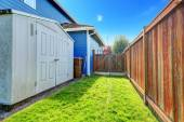 Small backyard area with shed — Stock Photo