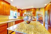 Shiny luxury kitchen room with island — Stock Photo
