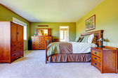 Master bedroom interior in bright green color — 图库照片