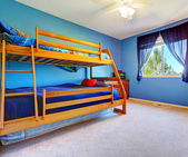 Bright blue bedroom with bulk bed — Stock Photo