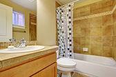 Bathroom with tile wall trim — Стоковое фото