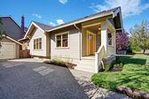 House exterior with white porch and orange door — Stock Photo