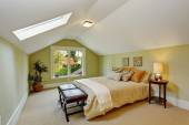 Bedroom interior with vaulted ceiling and light mint walls — Stock Photo