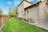 House with small deck and backyard — Stock Photo