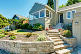 Front yard landscape with stone trim. House exterior — Foto Stock