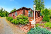 Log cabin style house exterior with curb appeal — Stock Photo